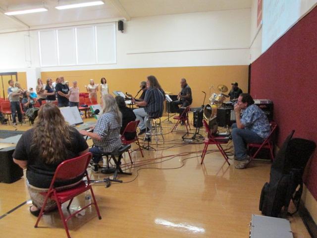 The worship team harmonica, guitars, electric organ & drums